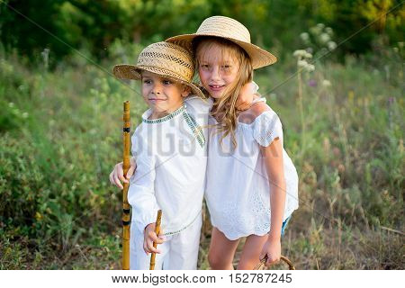 brother and sister on walk warm summer vacations close up