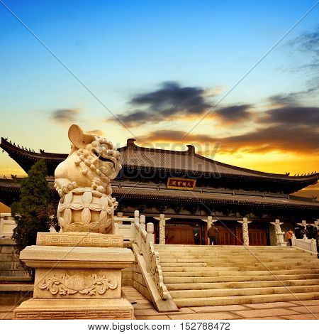 Dusk Chinese classical architecture temples and lions.