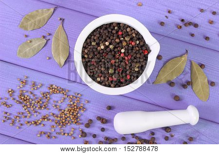 Colorful Pepper In Mortar And Spices On Purple Boards