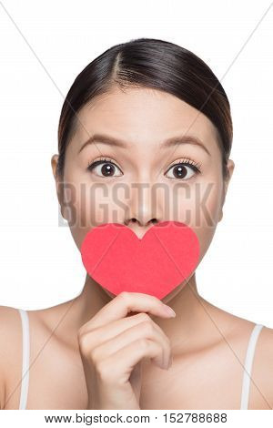 Cute attractive young woman with red heart. Valentine's day art portrait. Perfect make up