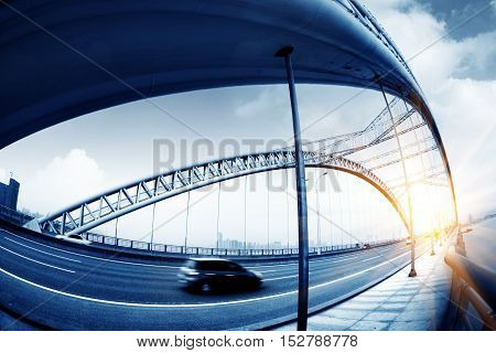 highway and modern bridge of cityblue toned.