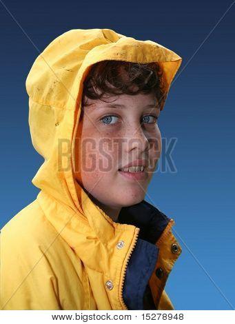 Boy in yellow raincoat, isolated.