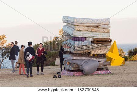 5 November 2013: Bondi Beach, Sydney, Australia - People Looking At Stack Of Mattresses Exhibit At S