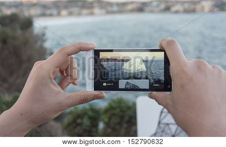 5 November 2013: Bondi Beach, Sydney, Australia - Person Interacting With A Digital Hologram Exhibit