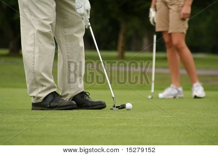Man putting, woman in background, shallow dof.
