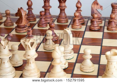 A some chess pieces on the chessboard