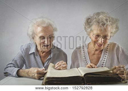 Old friends reading a book