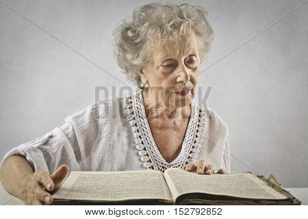Classy elderly woman reading a book