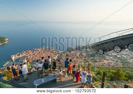 Dubrovnik, Croatia - July 21, 2016: Tourists on the cableway observation platform above Dubrovnik, Croatia