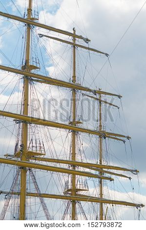 The Old sailing boat rigging on the background sky