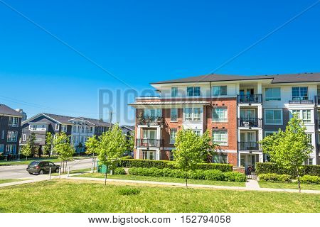 Brand new low rise apartment building on sunny day in British Columbia Canada