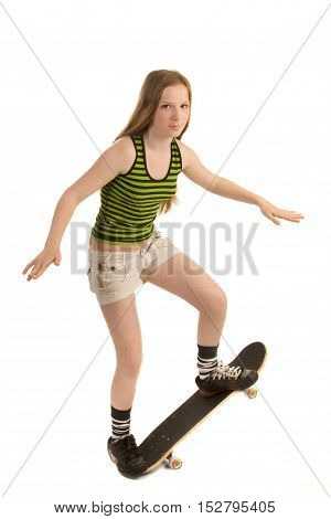 Teenager-skateboarder is doing a stunt isolated on white background