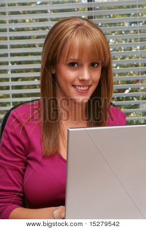 Pretty girl behind a laptop.