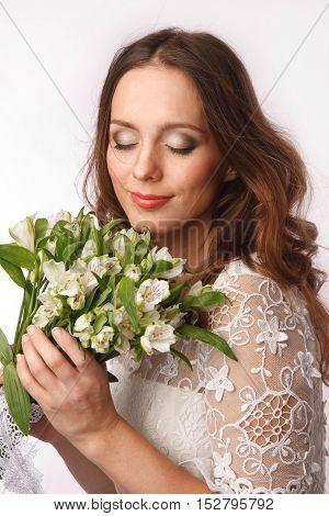 Bride dressed hippie stile with flowers studio shoot