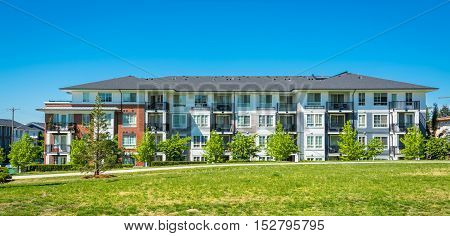 Brand new apartment building on sunny day in British Columbia Canada
