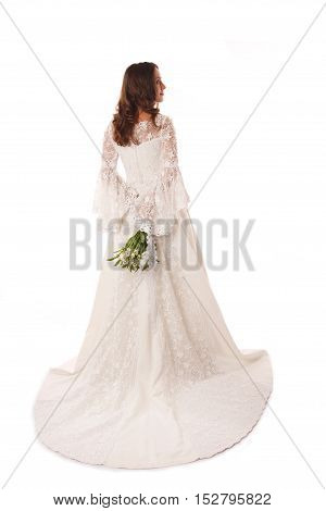 Back view of bride in wedding dress with long lace train
