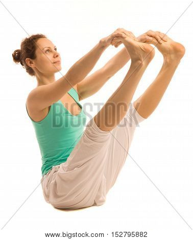 Young woman-yoga instructor doing yoga. Isolated on white