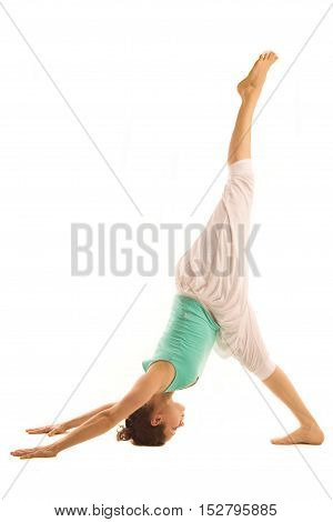 Woman -real yoga instructor is standing on the head.Isolated on white