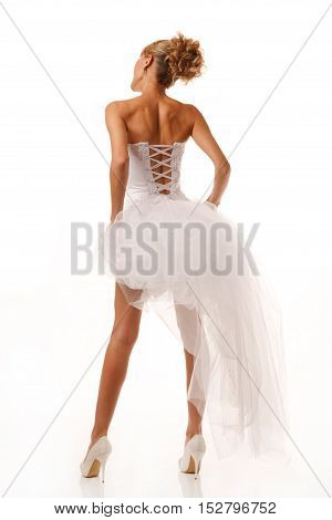Photo of long leg standing brides back.Isolated on white