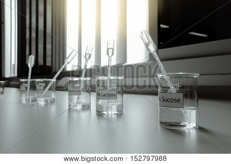 Solution in beakers with dropper science laboratory