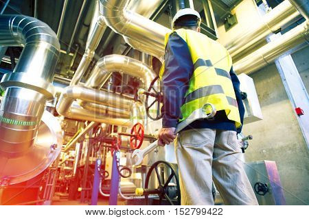 Industrial Worker With Spanner At Factory
