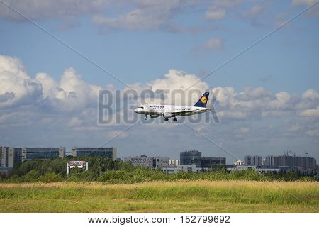 SAINT PETERSBURG, RUSSIA - JULY 24, 2015: The Airbus A319 of Lufthansa is on the landing in Pulkovo airport. Saint Petersburg
