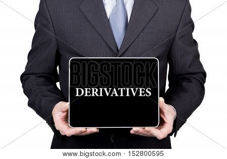 derivatives written on virtual screen. technology, internet and networking concept. man in a business suit and tie holds a PC tablet.