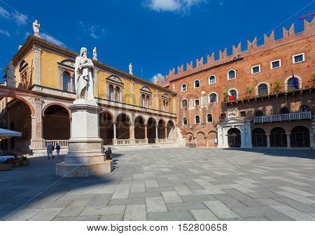 VERONA ITALY- September 08 2016: View on Piazza dei Signori also called Piazza Dante a medieval square in the old town of Verona and Dante Alighieri monument at the center of Piazza dei Signori.