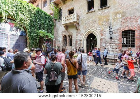 VERONA ITALY- September 08 2016: Tourists near house of Juliet Capulet (Giulietta Capuleti) with balcony made famous by William Shakespeare love tragedy Romeo and Juliet