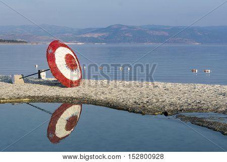 Laying beach umbrella at the lake. Wide angle image