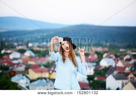 Young Pretty Girl Making Selfie