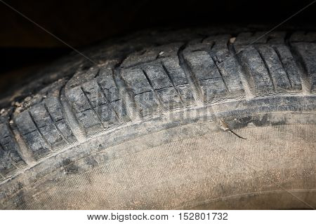 old black tires of car wheel on road