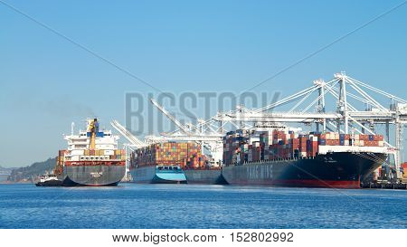 Oakland CA - September 26 2016: Cargo Ship NIKOLAS entering the Port of Oakland the fifth busiest port in the United States.