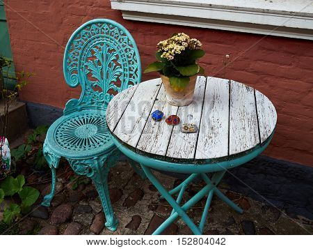 Vintage old fashioned classical design typical cafe chairs with table by a house Denmark