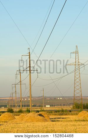 High-voltage Power Transmission Line. Energy Pillars. At Sunset, Dawn. High-tension