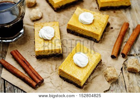 greek yogurt pumpkin pie bars on wood background