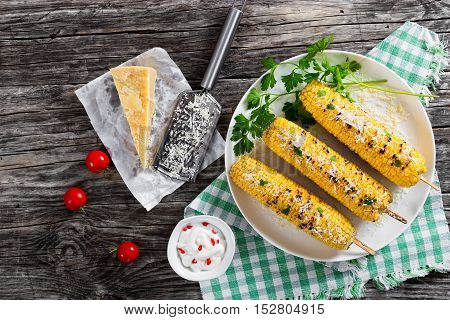 Grilled Corn With Cheese And Parsley On White Dish