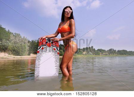 Young Sexy Woman In Bikini Posing With Wakeboard