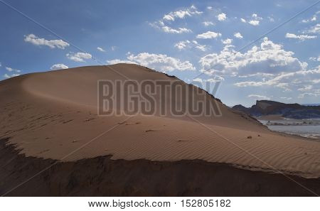 Beautiful sand dune with leading lines of sand into the atacama desert