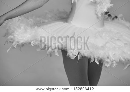 Closeup of ballerina's white dress while she is dancing the Swan Lake.
