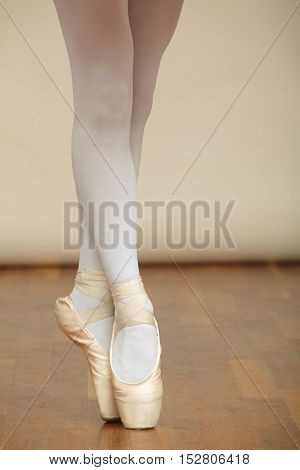 Closeup of ballerina's legs with ballet shoes.