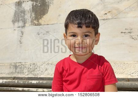 Portrait of smiling boy in the temple of Apollo.