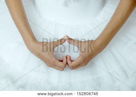 Closeup of ballerina's hands as a hard shape.