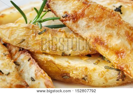 Potato wedges with parmesan and herbs.