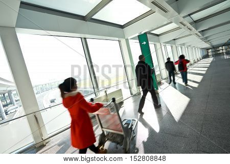 People In Sunny Windows Modern Airport Station Aisle
