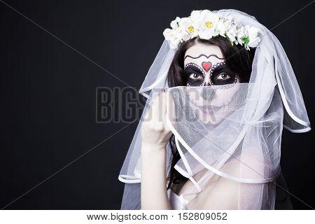 Woman Bride With Creative Sugar Skull Make Up And Bridal Veil Over Black
