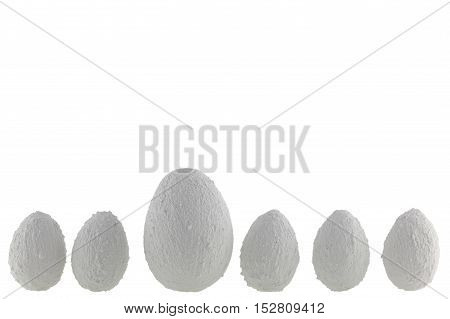 Several eggs of stone on a white background.