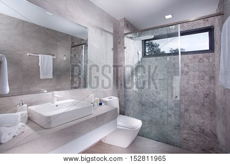 view of nice tiled contemporary modern restroom