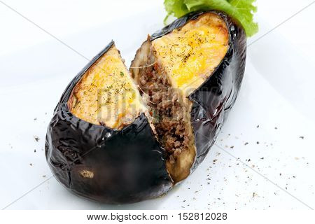 close  up view of nice yummy baked eggplant  on white back