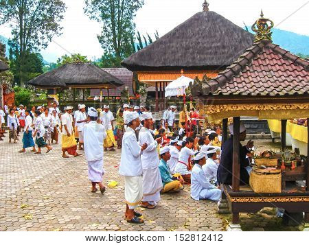 Batur Selatan, Indonesia - January 28, 2012: The people at traditional Hindu ceremony at Bali in Indonesia